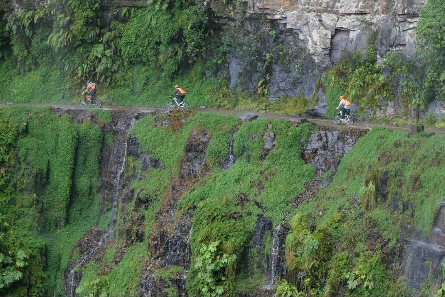 bikers radong along the narrow od death in north yungas road in bolivia