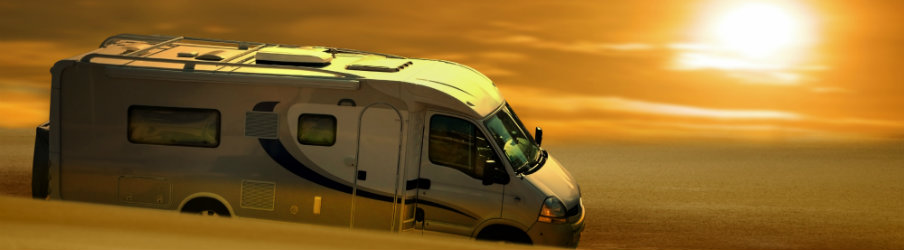 RV traveling under the sunset