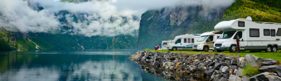 Motorhomes parking beside the lake