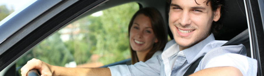 couple driving car cheerfully together