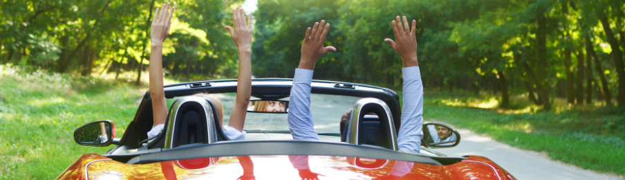 couple enjoying their road trip with a reliable car rental