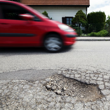 driving beside pothole
