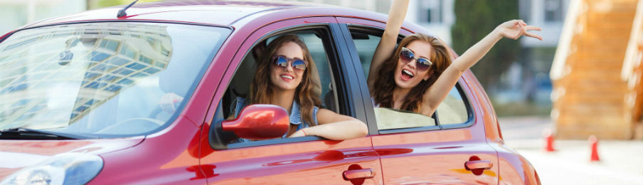 happy friends using car rental