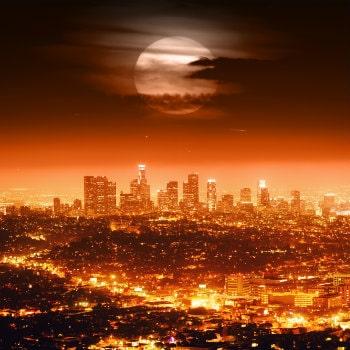 full moon over los angeles skyline at night