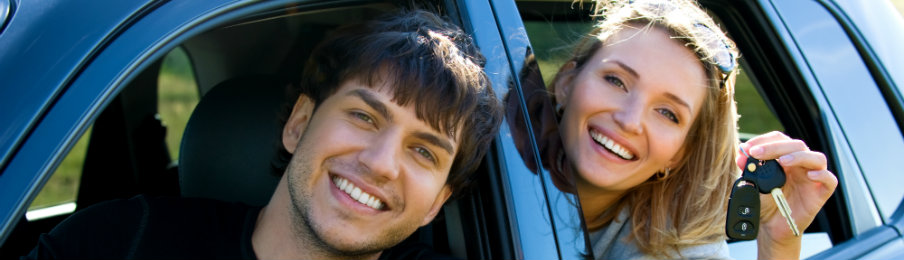 woman holding a car key with a man in the car