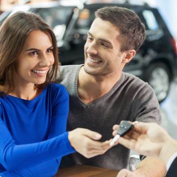 happy couple successfully book a car rental