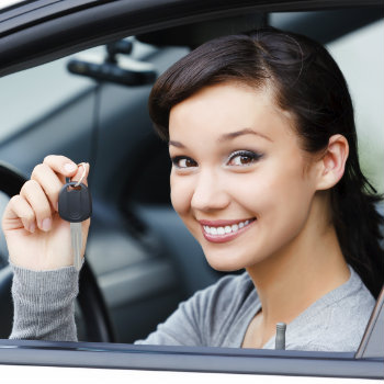 woman holding key inside car