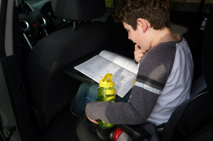 kid reading an activity book