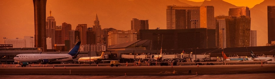 airplanes parked at the Las Vegas Airport runway at sunset