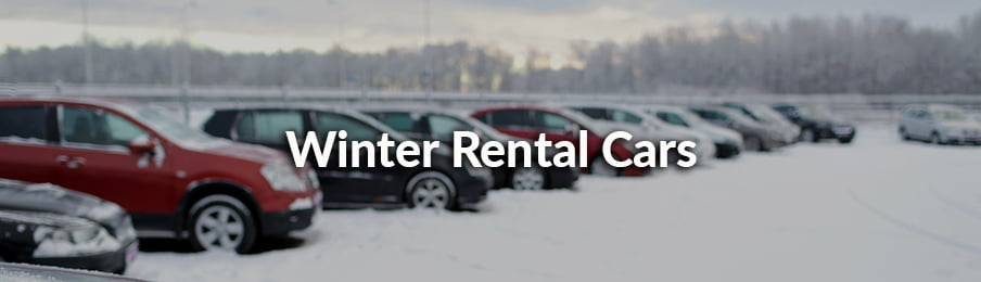 Rental cars parked at the parking area during winter season