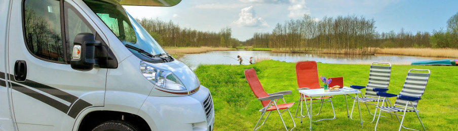 RV rental parked beside a lake and picnic area