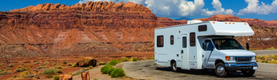 RV rental in Canyonlands, USA with red cliffs