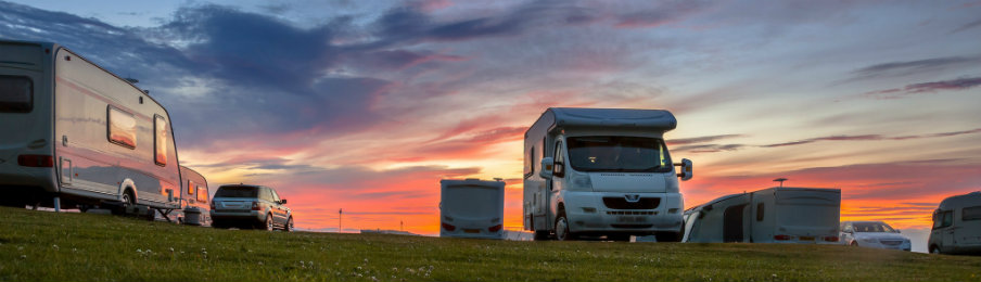 reliable motorhome and rv rentals parked during sunset
