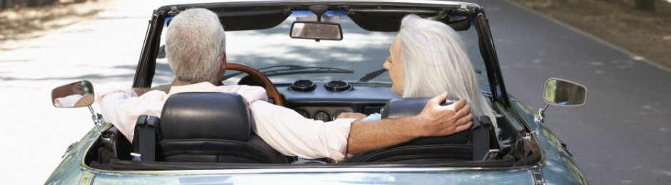 senior couple driving a car