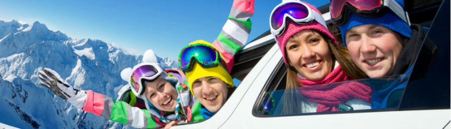 happy family on a winter trip riding a car rental