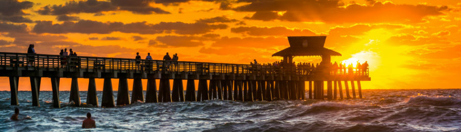sunset over the fishing pier in naples, florida