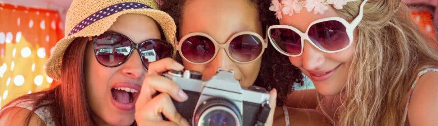 three women on holiday taking photos