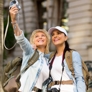 female tourists taking selfie