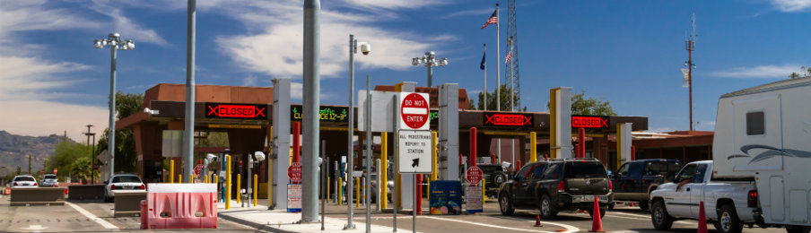 us entrance gate at international border of us and mexico
