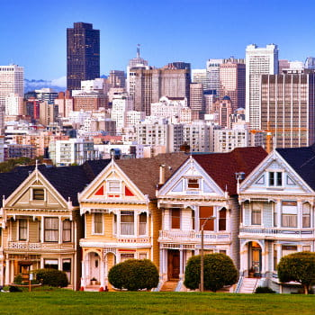 Victorian houses in San Francisco skyline at Alamo Square