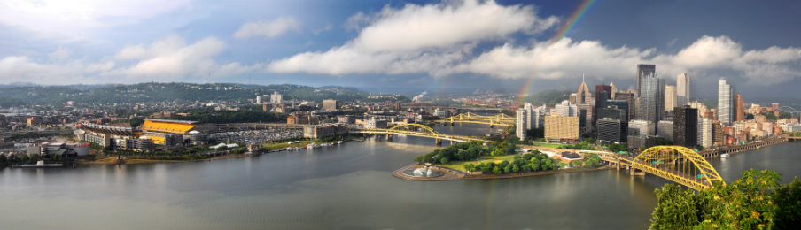 view of Pittsburgh with rainbow in late afternoon