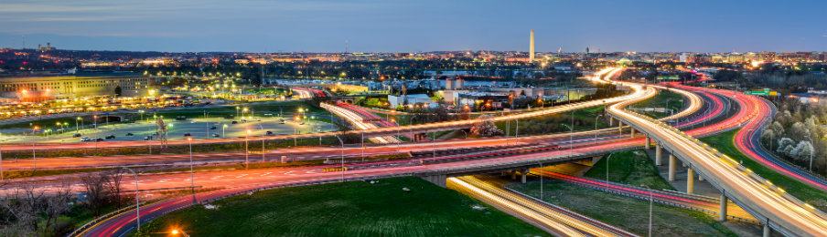 washington dc skyline at night with highways and monuments