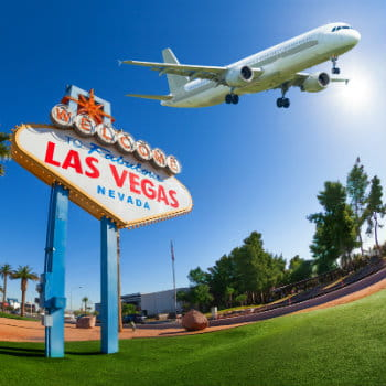 Welcome sign at Las Vegas with airplane