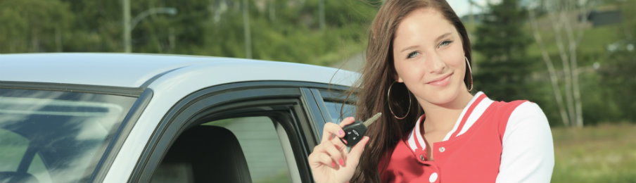 woman holding her car keys beside her rental car