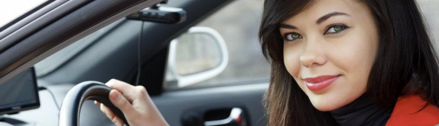 pretty woman driving a rental car