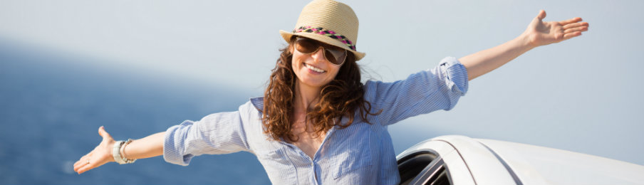 happy woman using car rental