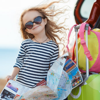 young girl holding map going for vacation